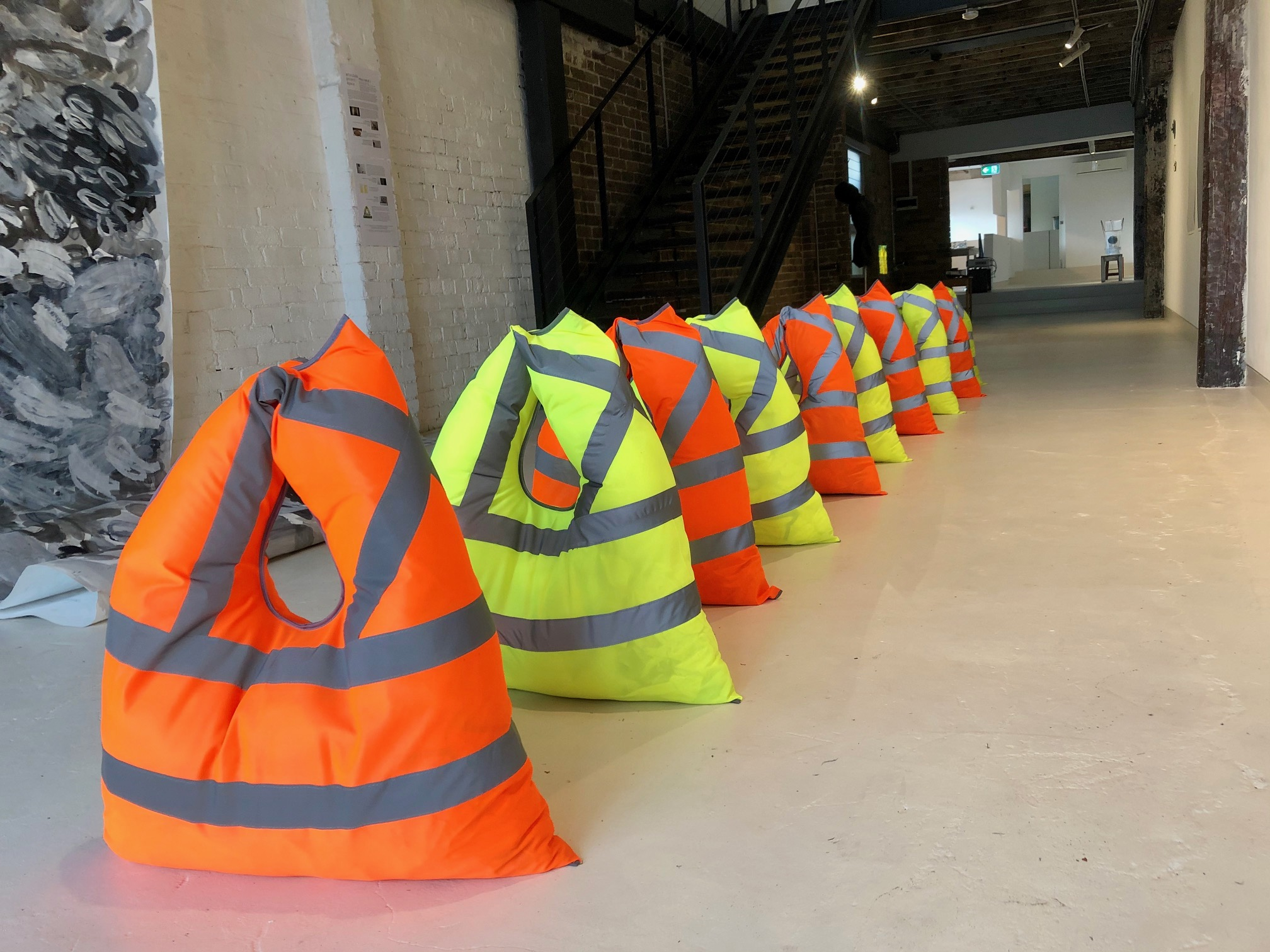 safety vests, climate change, barriers, contemporary art